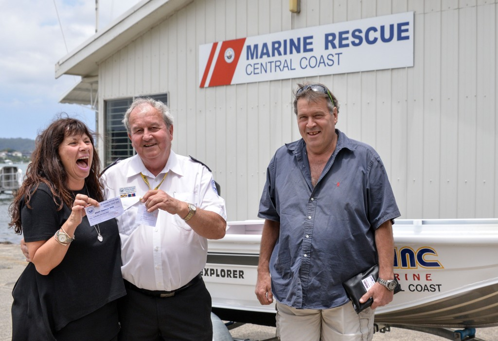 A happy and excited Deborah Frack collects her boat and trailer from CMDR Roger Palmer while husband Bradley looks after the paperwork