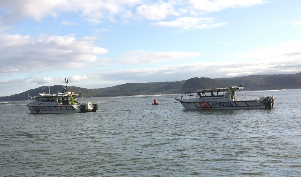 Rescue vessel TG30 afloat again and in tow by  Cottage Point 30