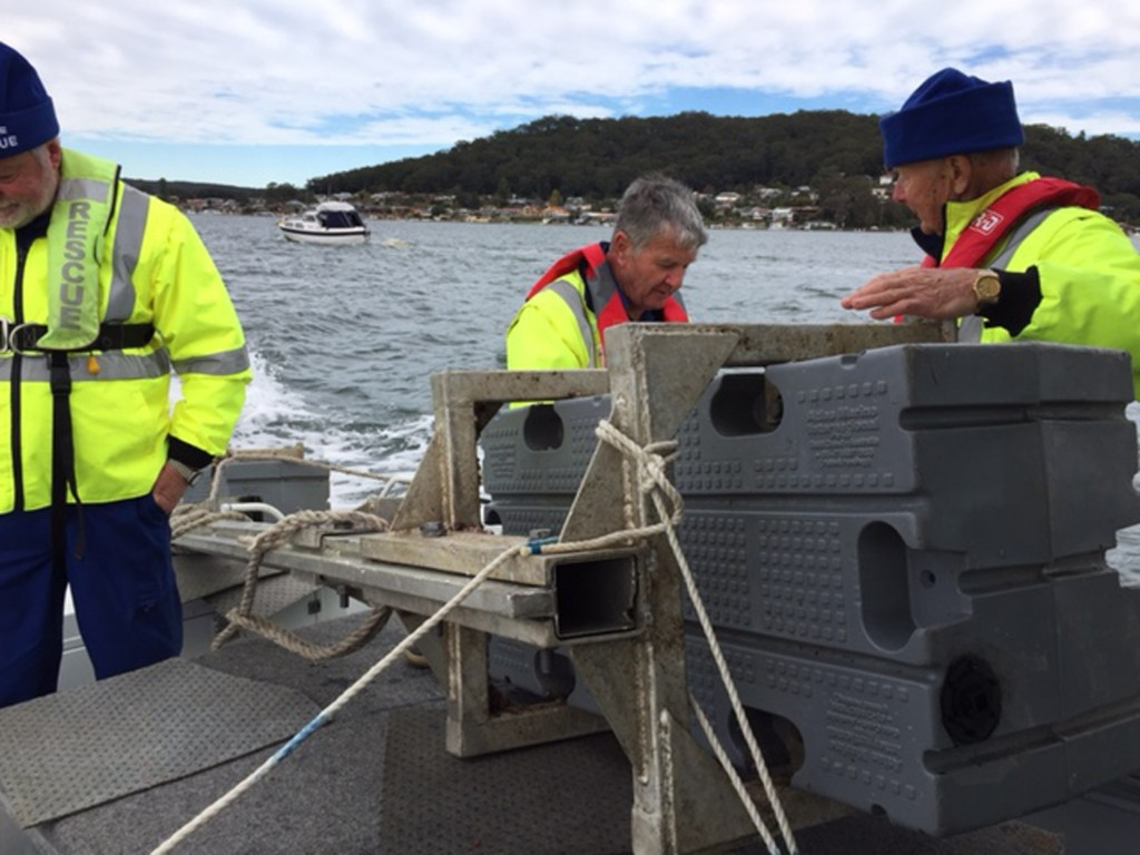 Ken Sharp (rear), Karl Liepa (right) and Duncan Coles with 'rescued' floating debris aboard Central Coast 21 returning to Point Clare Base