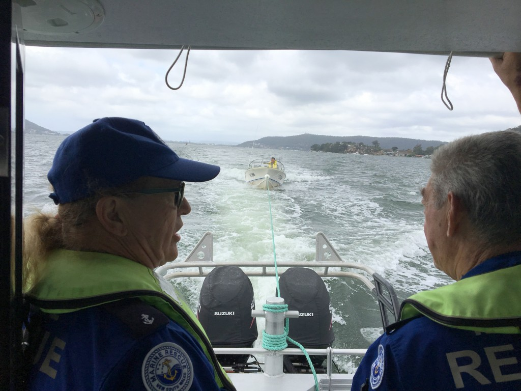 Max Landells (left) and Peter Fischer aboard Central Coast 22 control the tow from Blackwall