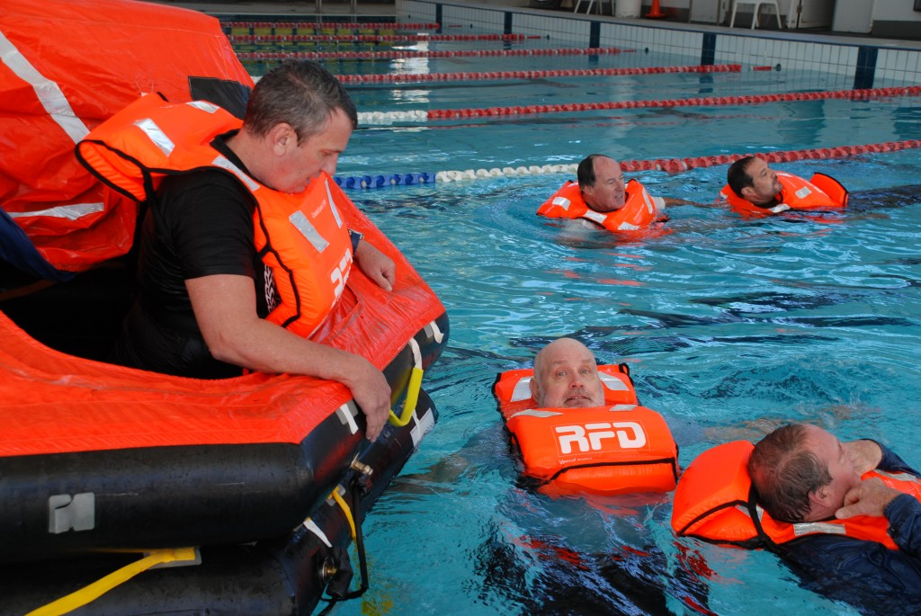 Preparing to assist in boarding liferaft at the pool at for Alberca water planet nuevo laredo