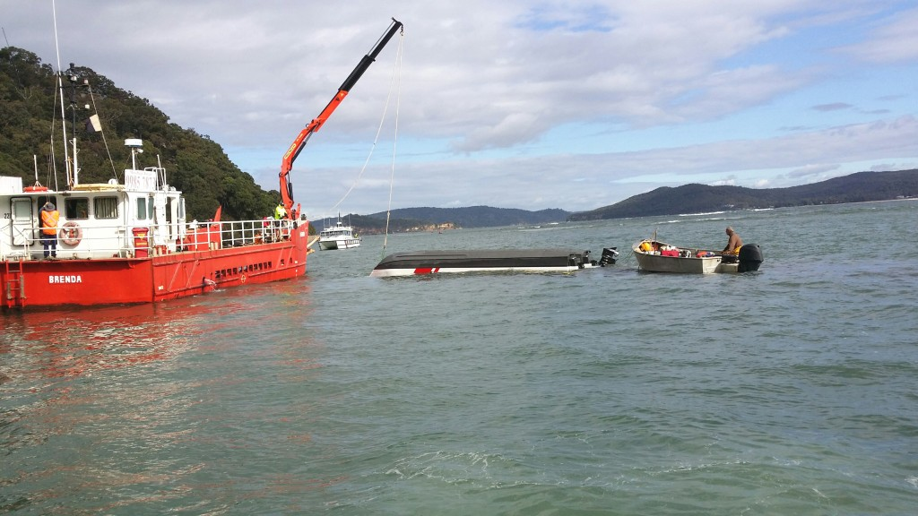 Salvage Barge from Brooklyn preparing to right marine rescue vessel