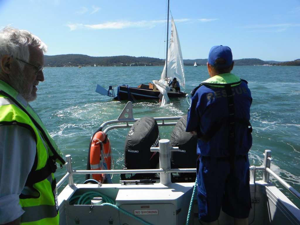 Capsized skiff on the Broadwater was righted and towed to Saratoga Sailing Club, Greg McNee (left) and Collis Harvey assisting